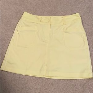 Nike golf skirt- yellow with a tiny striping